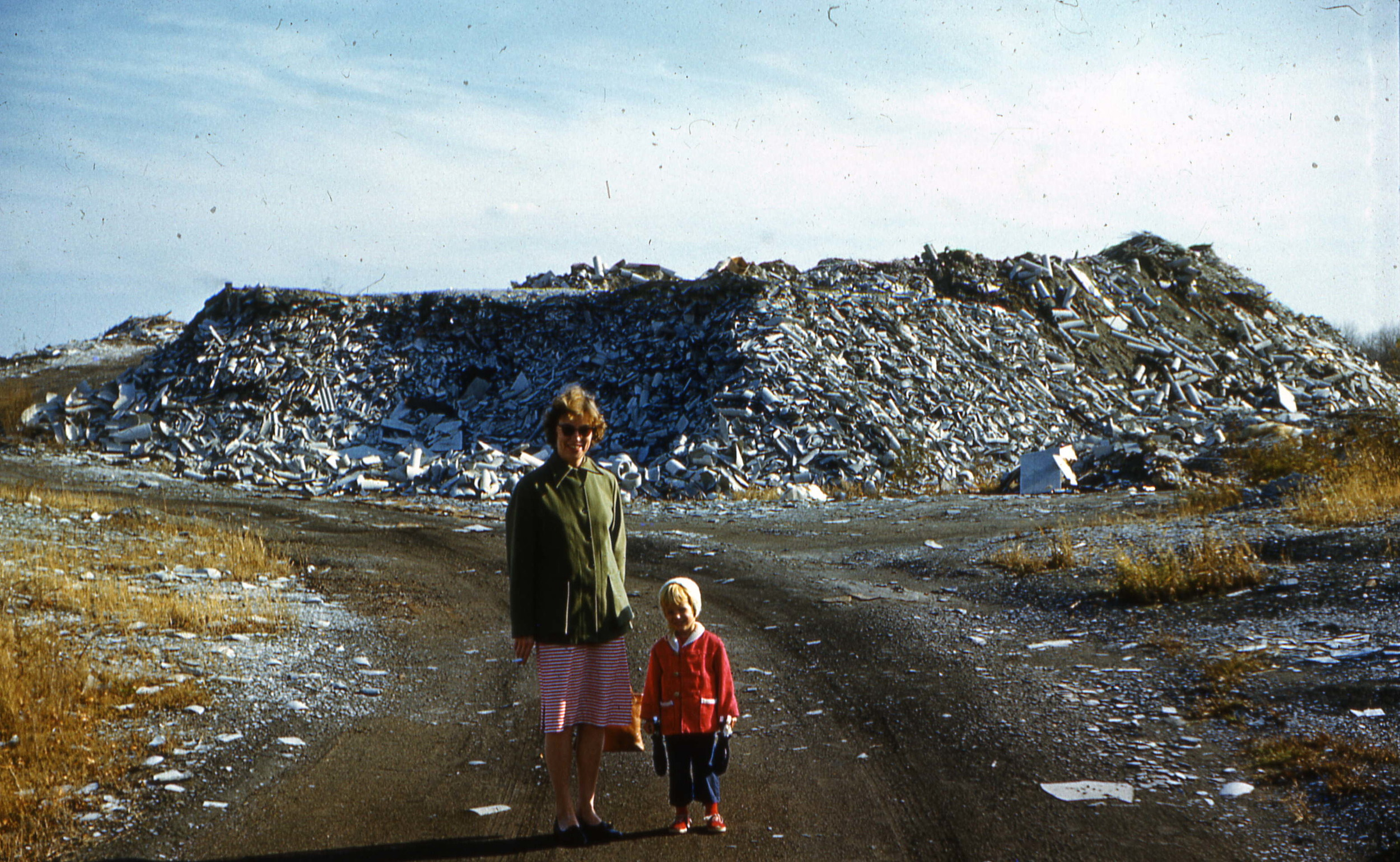 """Woman and child in front of the """"White Mountains"""" of Ambler, ca. 1960s.   Courtesy of Salvatore Boccuti."""