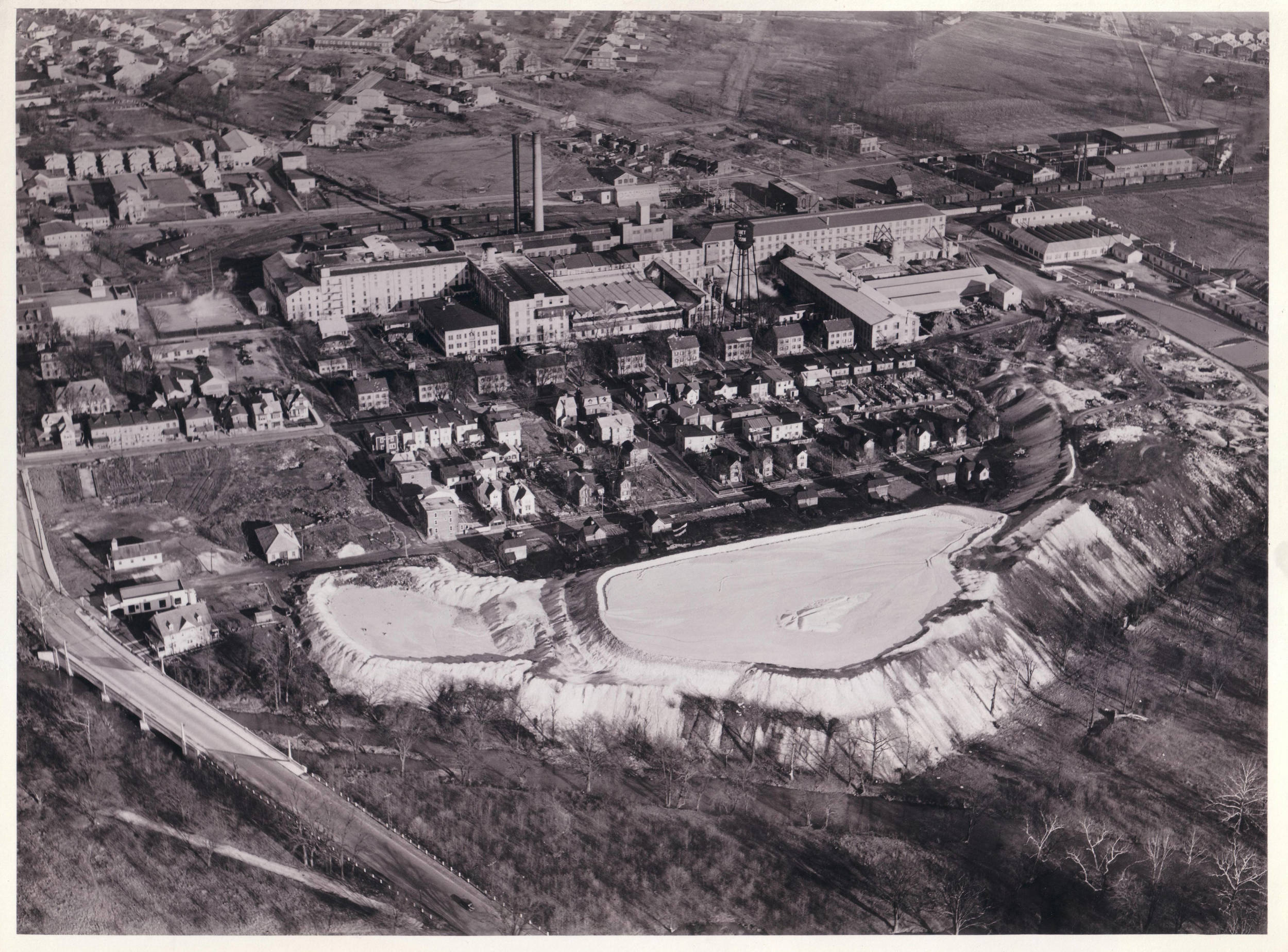 """Keasbey and Mattison factory, showing Ambler's """"White Mountains,"""" 1937.   Dallin Aerial Survey Company. Hagley Museum and Library."""