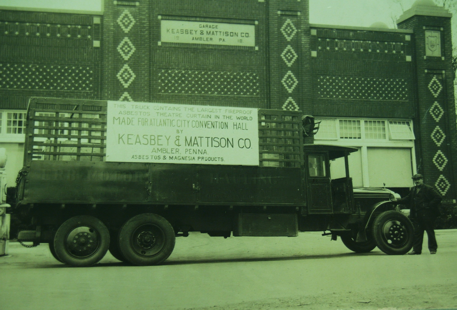 Keasbey and Mattison garage with truck advertising asbestos curtain, ca. 1920s.   Newton Howard Photograph Collection,Historical Society of Montgomery County.