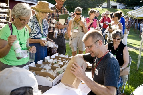 Conference attendees participate in a seed distribution in 2013 at Heritage Farm