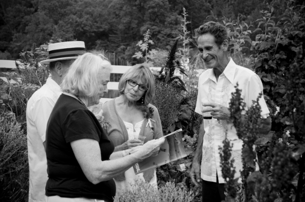 Seed Savers Exchange Co-Founder Diane Ott Whealy and Board member David Cavagnaro chat with guests in the gardens at a fundraising dinner.