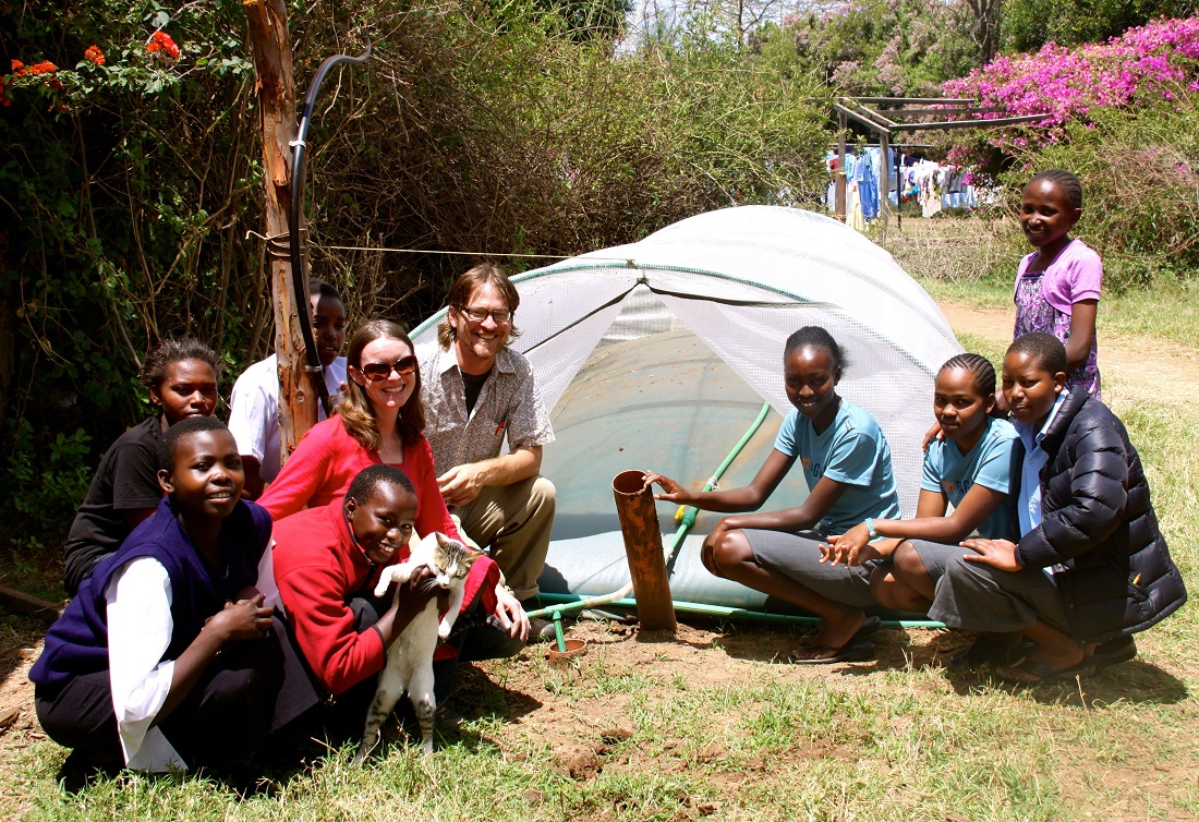 Marilyn and Chris pose with students at Daraja Academy in Kenya.