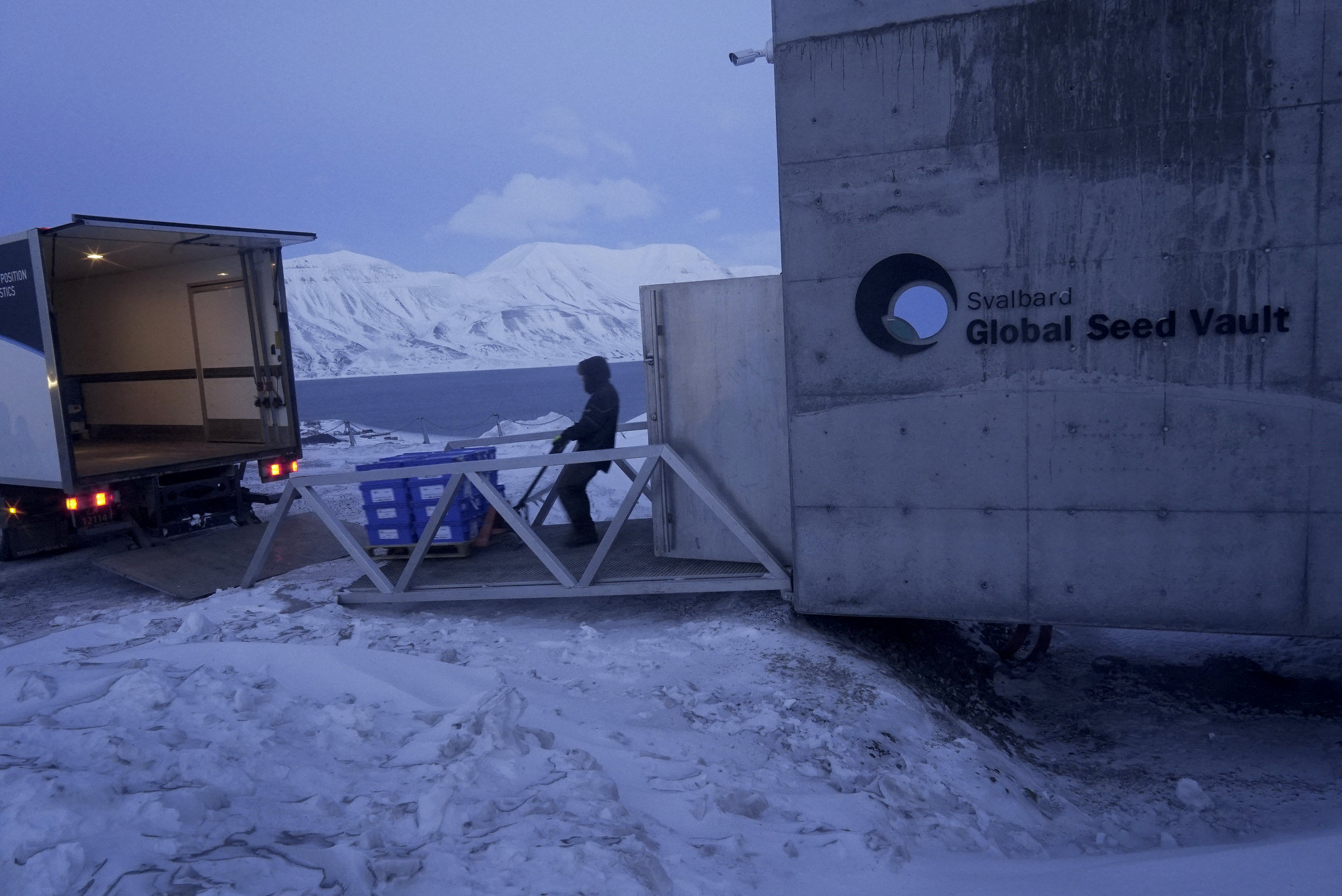 Pallets of seed boxes are ushered through Svalbard's entrance.