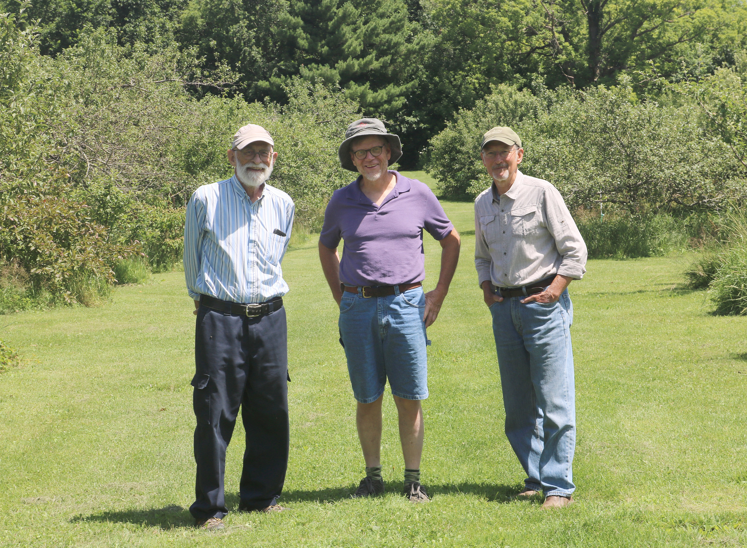 Men on a mission: Lorado Adelmann, Lindsay Lee, and David Sliwa (shown in SSE's Historic Orchard this July) grafted more than 1,000 apple trees over the better part of a week in February 1989,