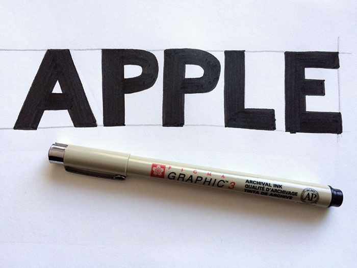 Fill letters with black ink. Broad tip marker will make this faster