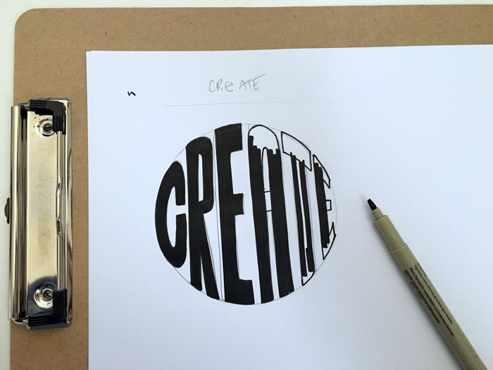 Fill in your hand lettered glyphs using a  wide-tip black inking pen .