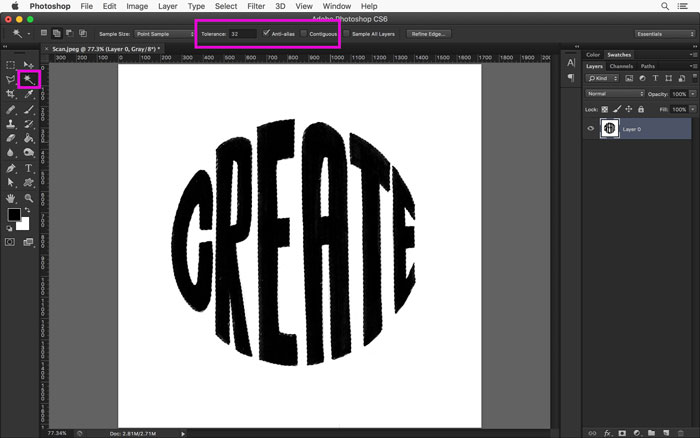 Isolate the black lettering from the white background in Photoshop using the Magic Wand tool.
