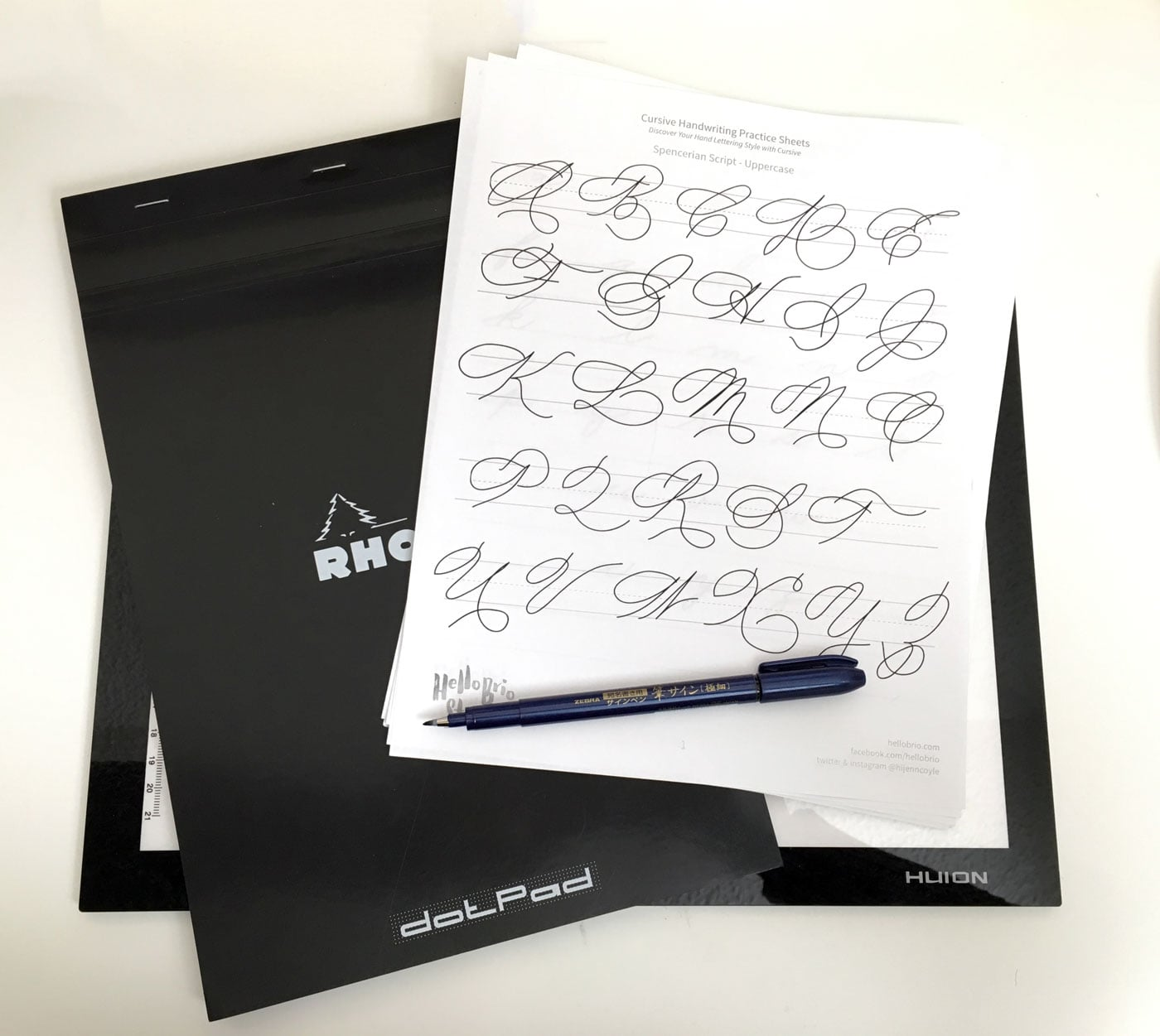 Materials needed to trace cursive worksheets: lightpad, rhodia dot pad, zebra brush pen, cursive worksheets