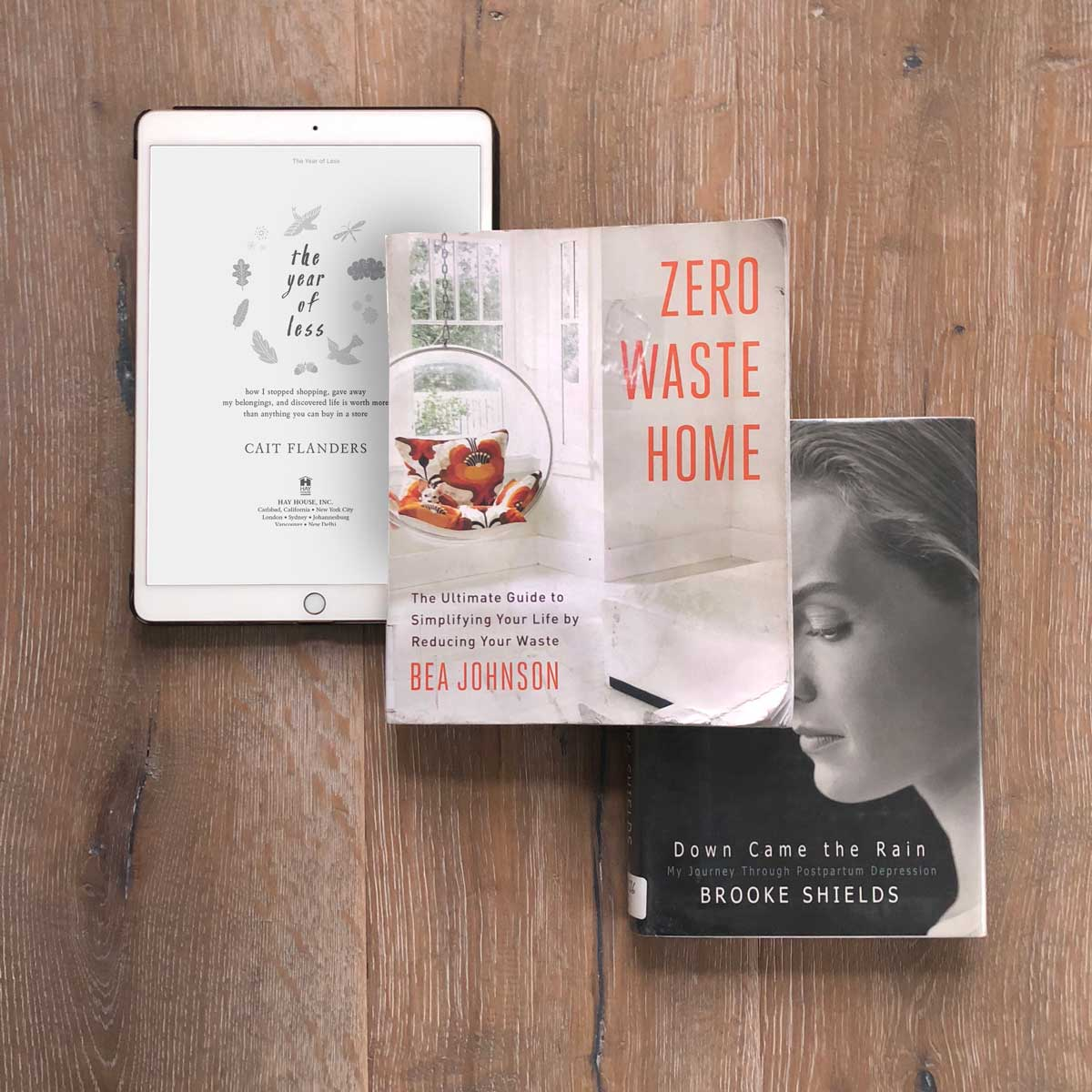 Library books - The Year of Less Cait Flanders, Zero Waste Home Bea Johnson, Down Came the Rain Brooke Shields