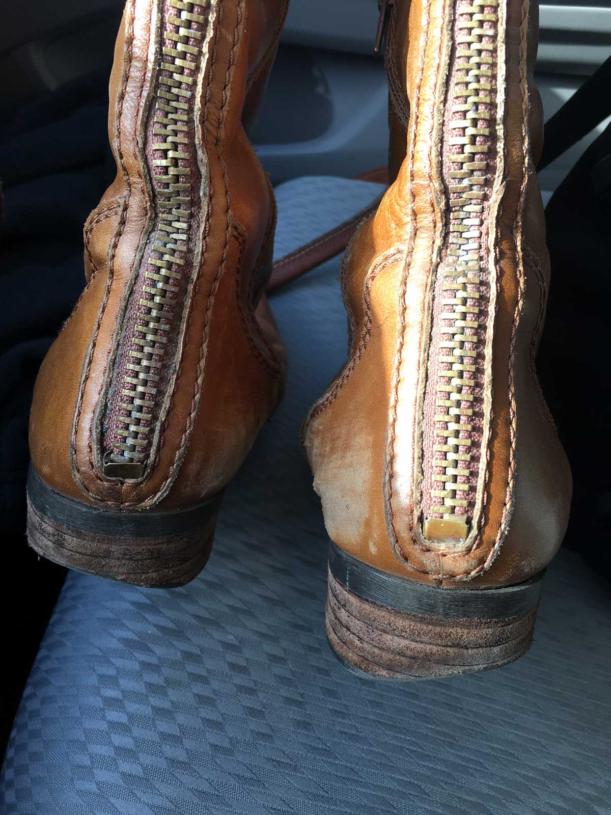 Boots before repair - the soles are in bad shape