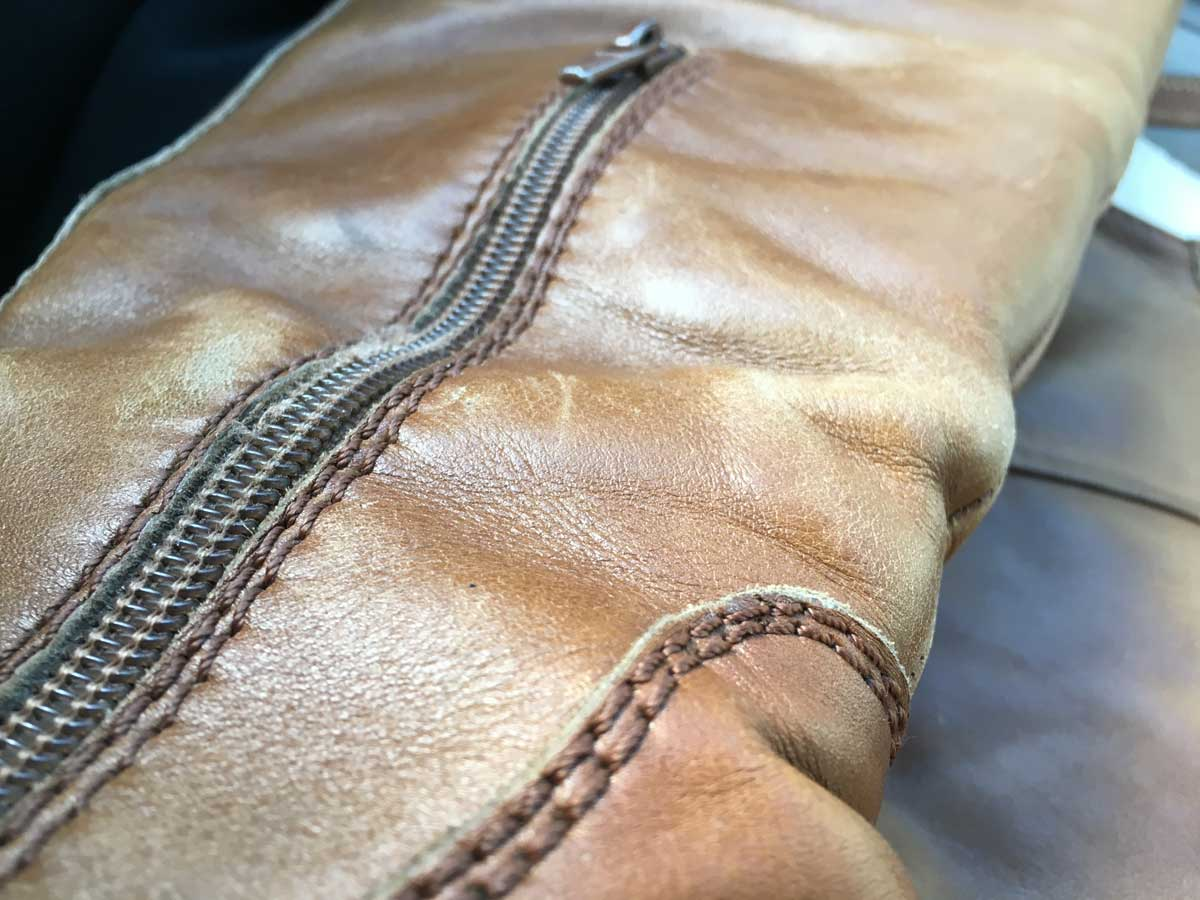 Boots before repair - the leather is worn down