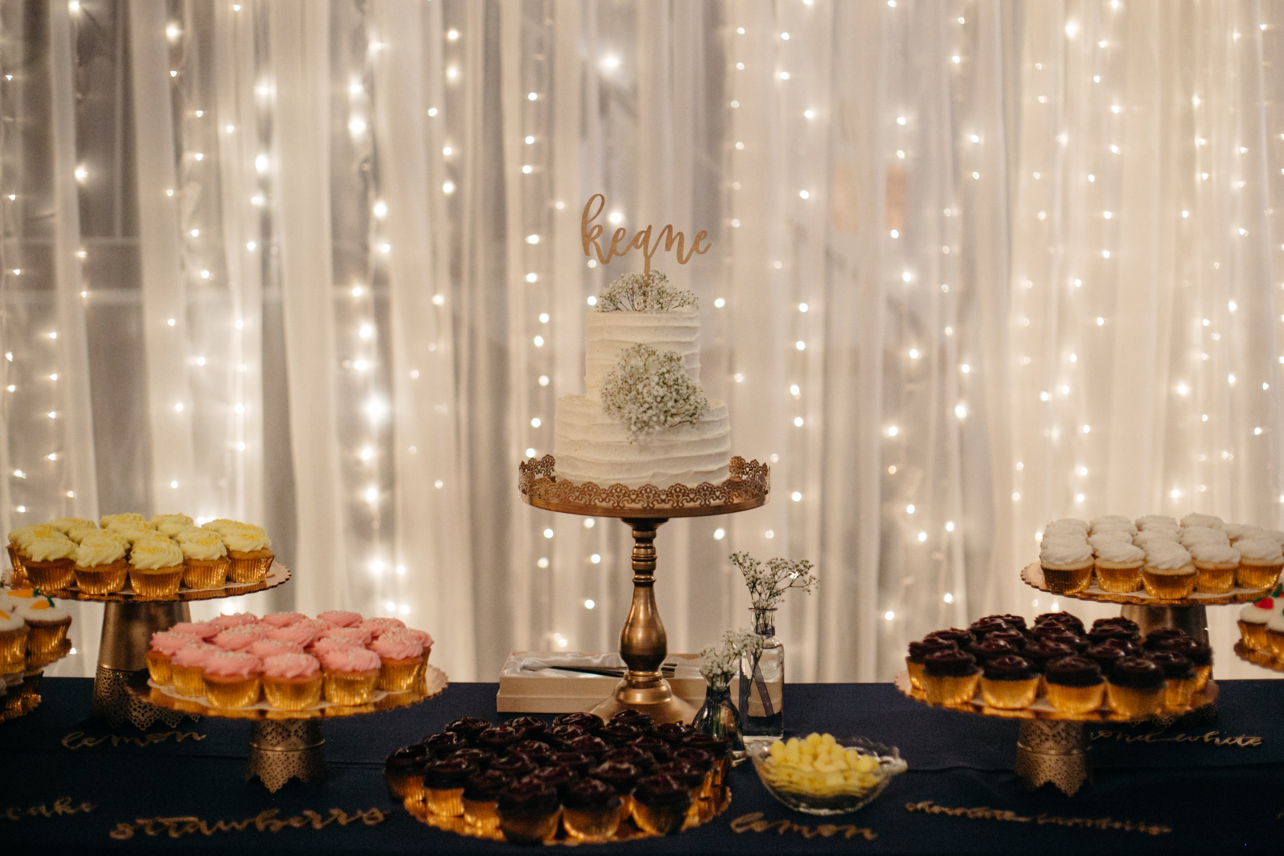 Lighted curtain behind cake table