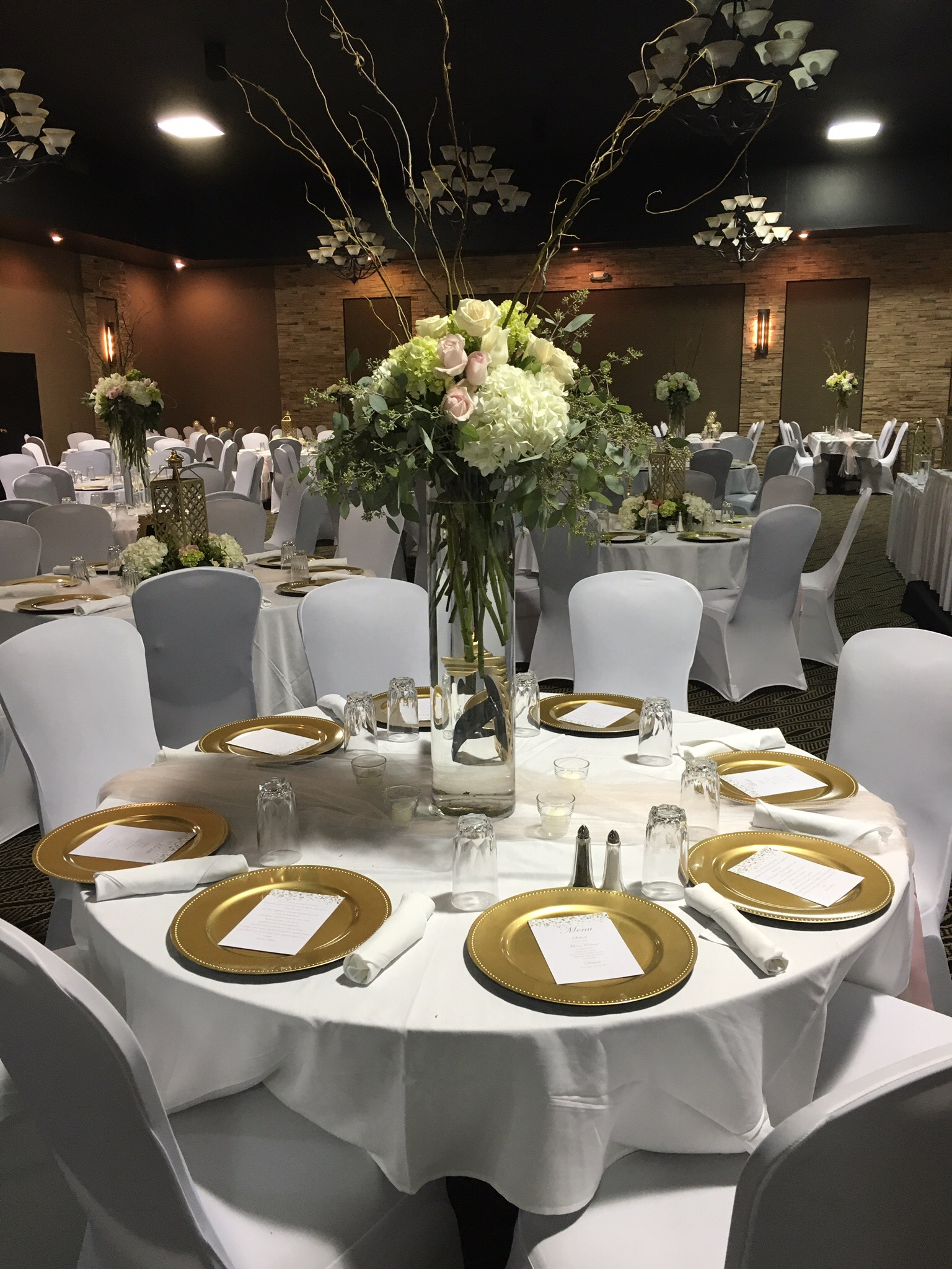 Gold chargers with white chair covers