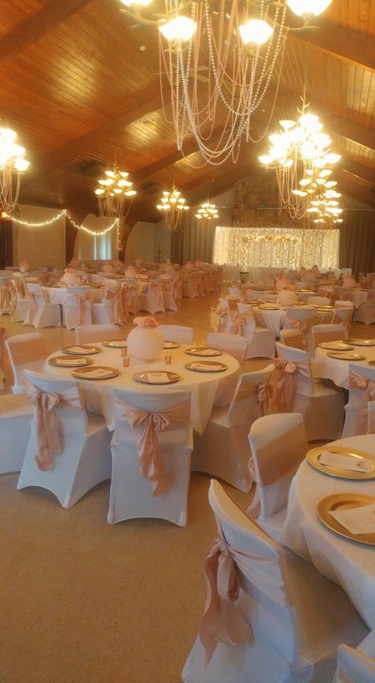 Blush sashes and white chair covers