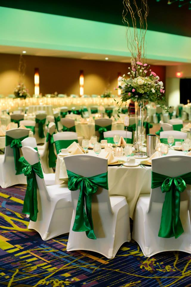 Green sashes with white chair covers