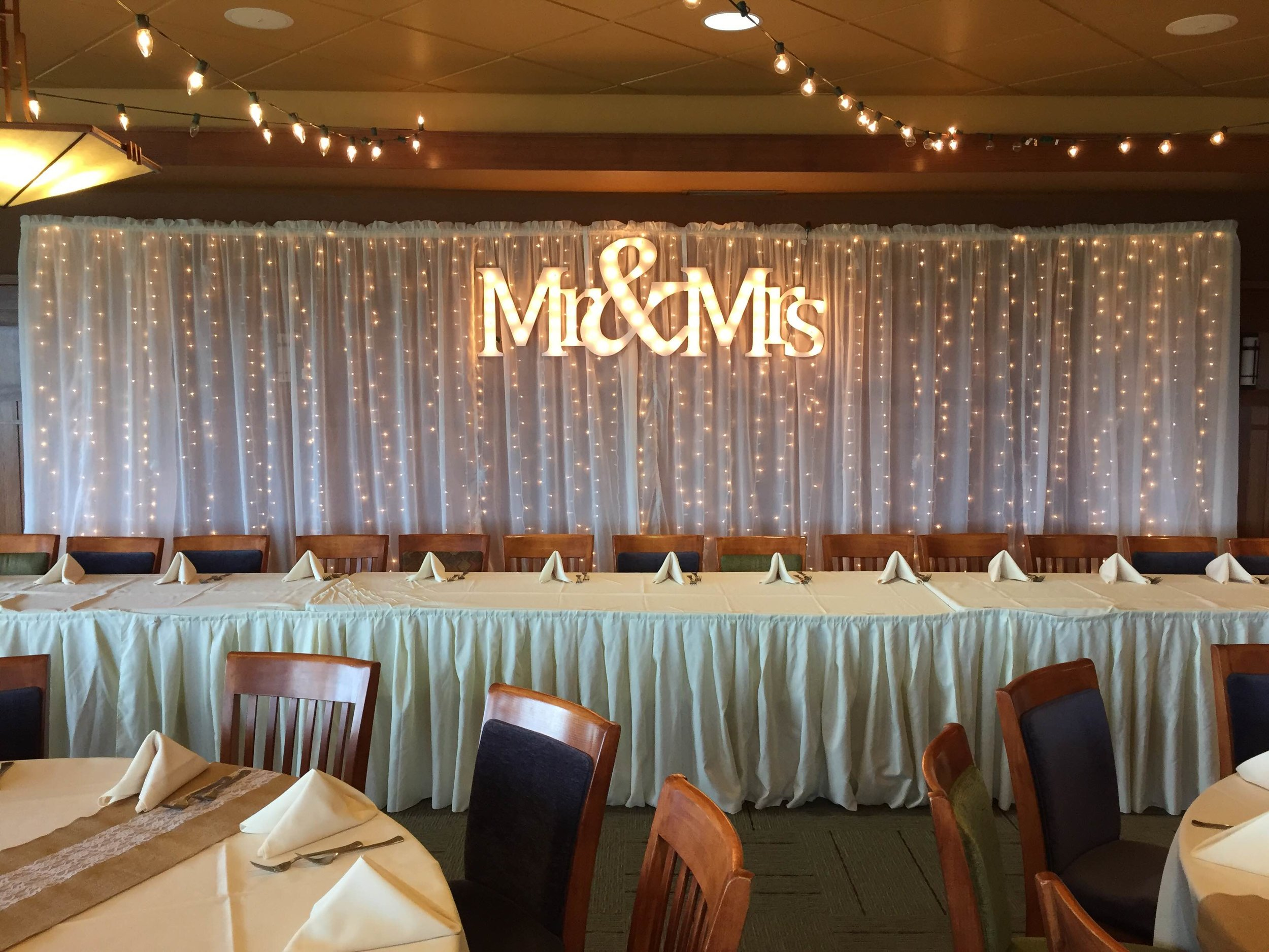 Mr. & Mrs. sign with lighted curtain