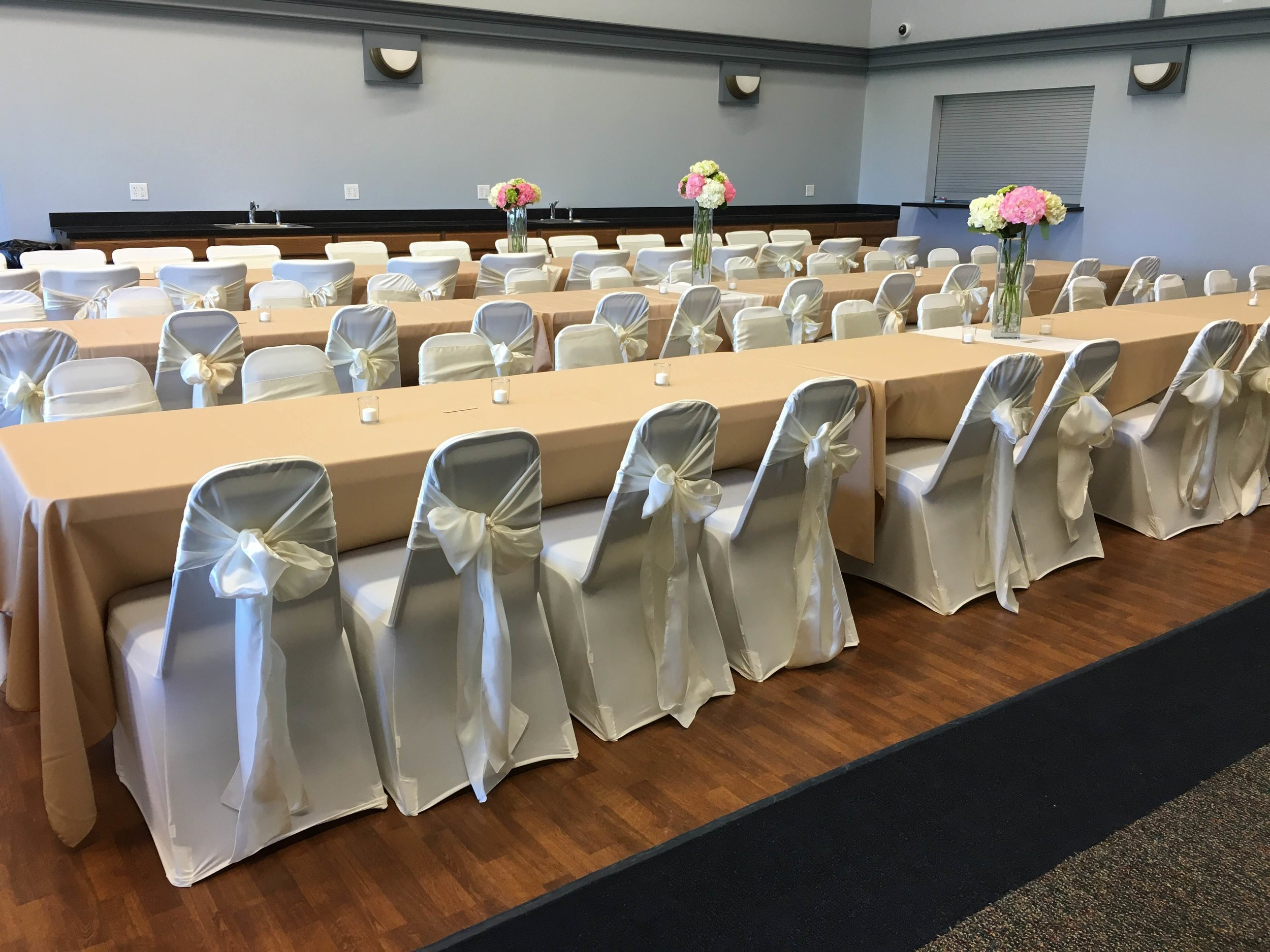 Ivory sashes and ivory chair covers