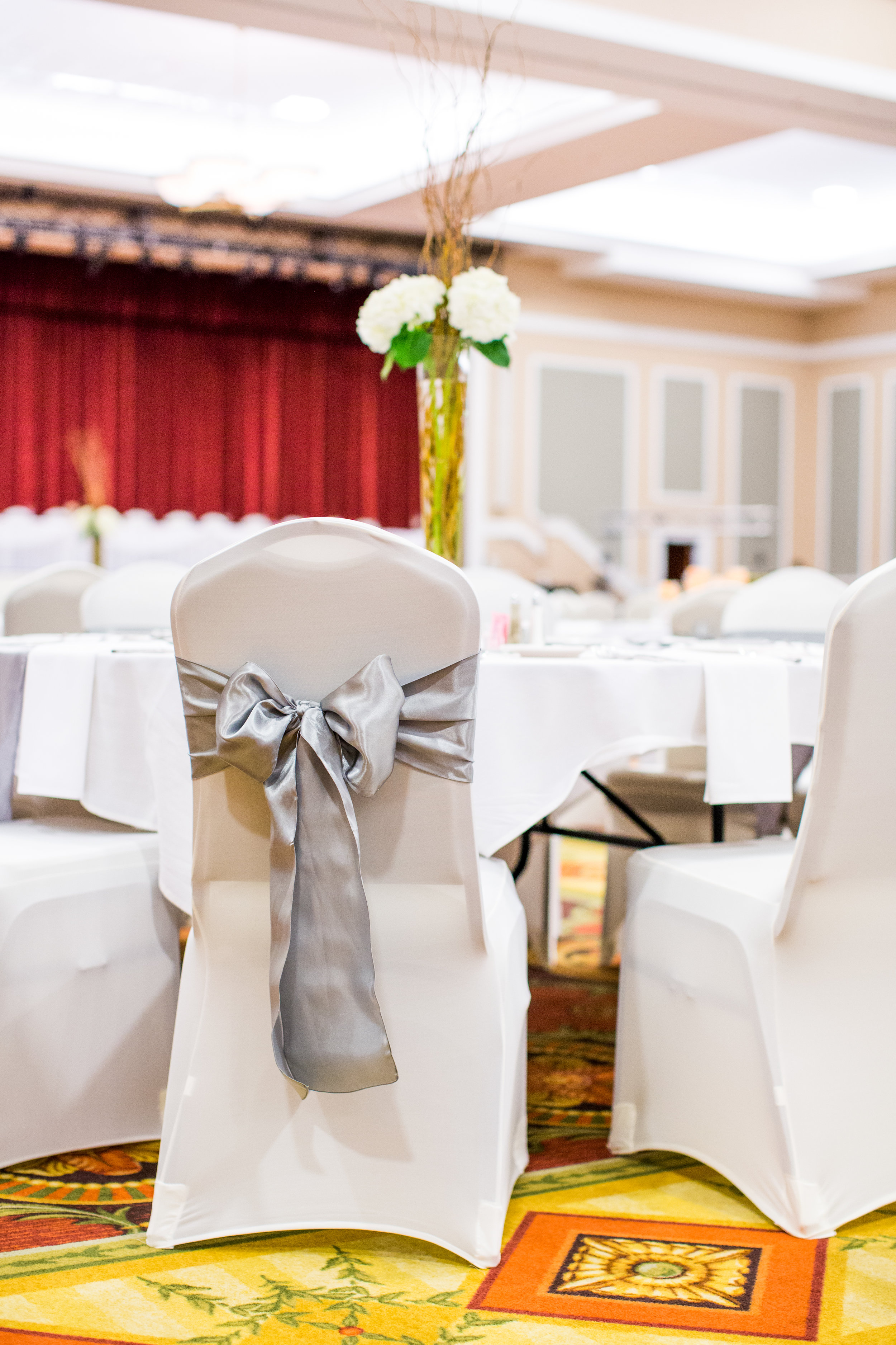 Gray sashes with white chair covers