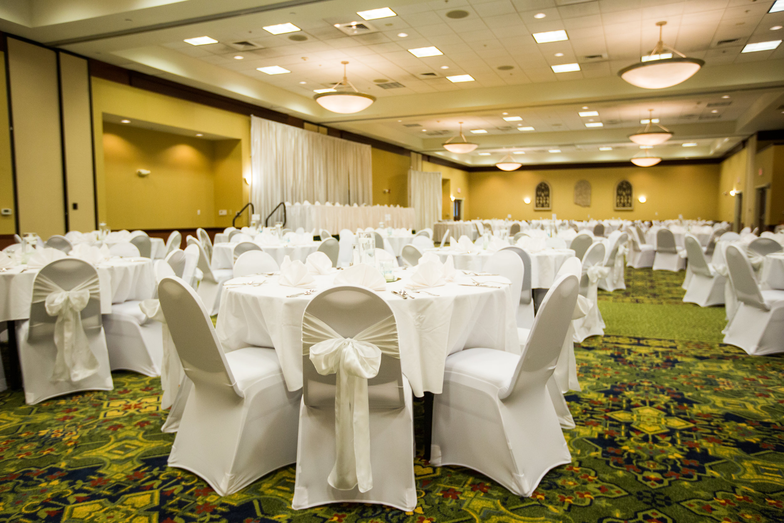 White sashes and white chair covers