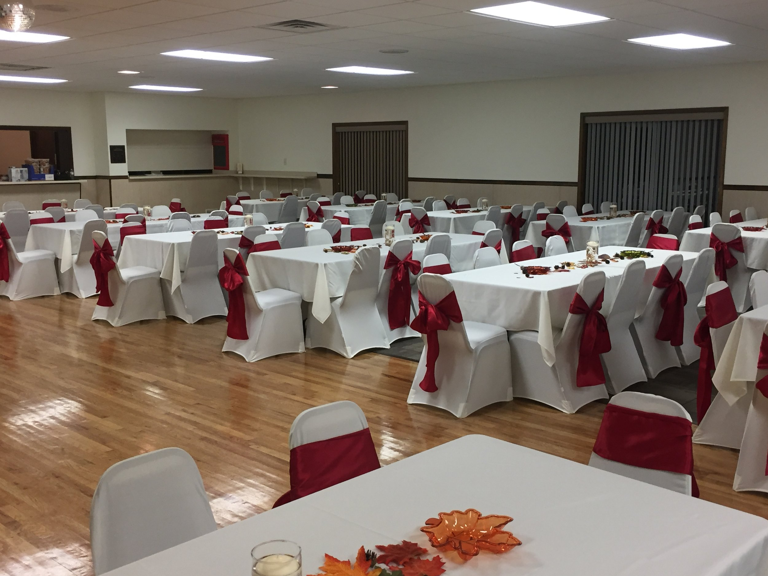 Red sashes with white chair covers