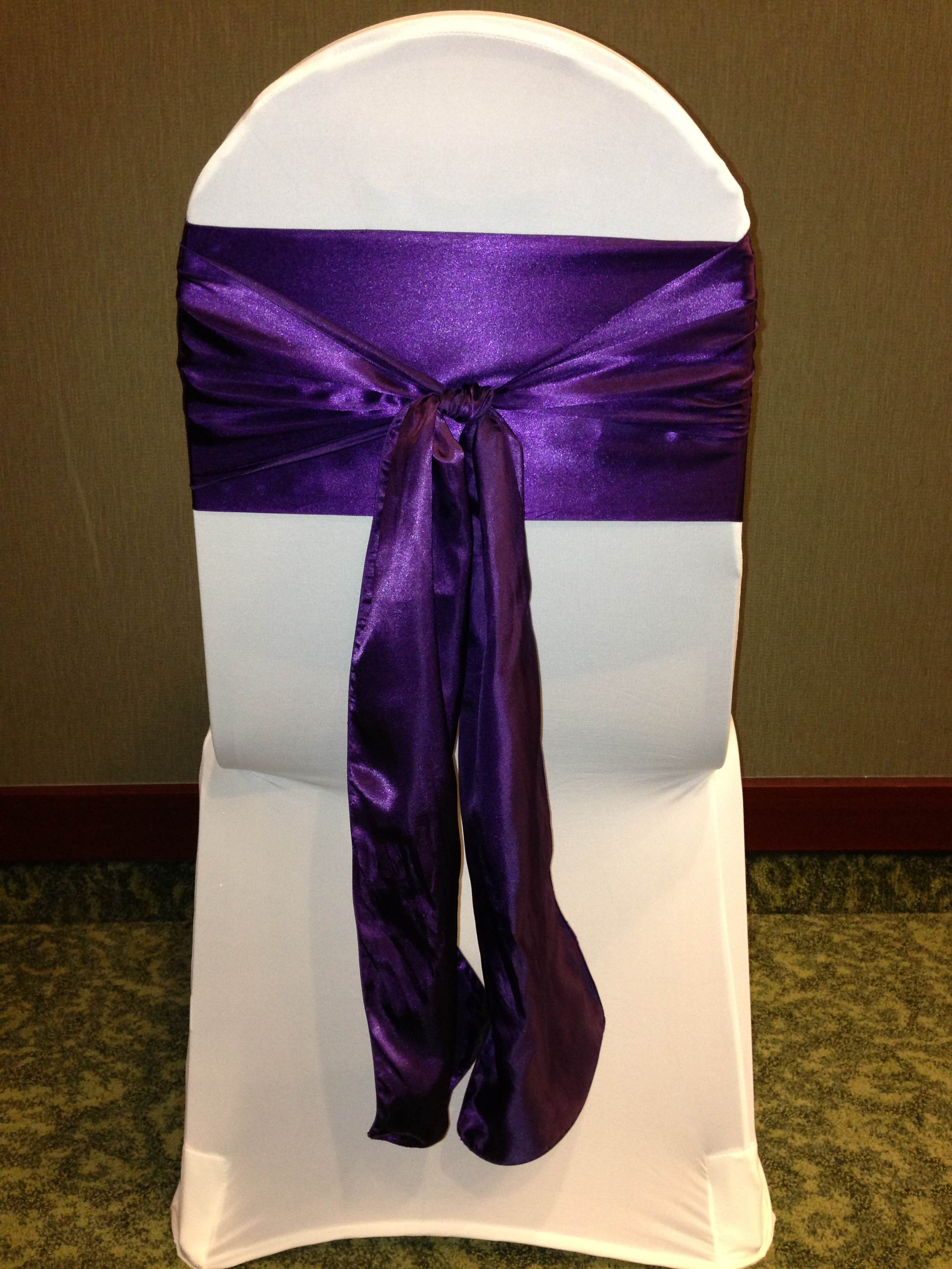 Purple chair cover and white sash