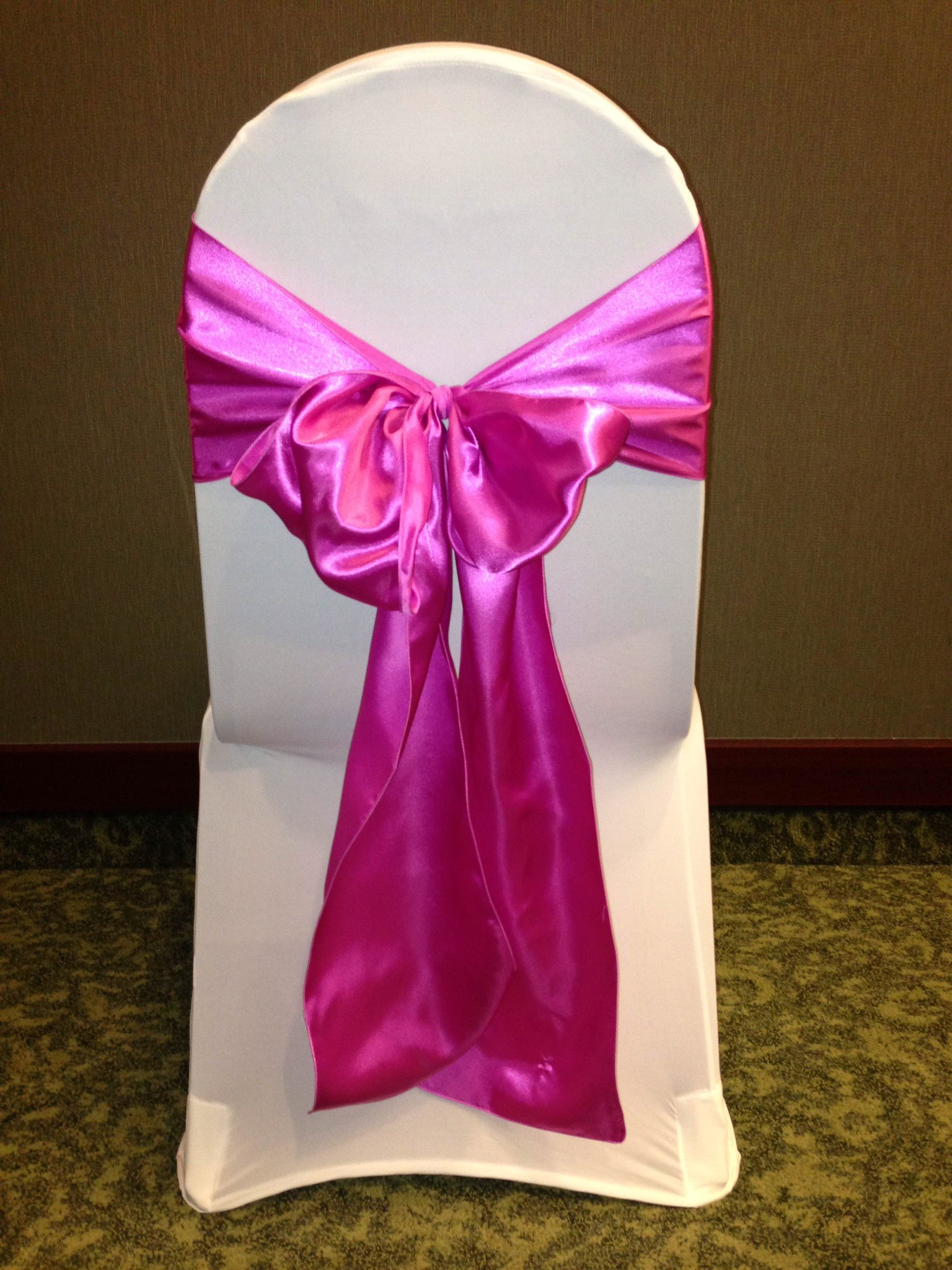 Pink sash and white chair cover