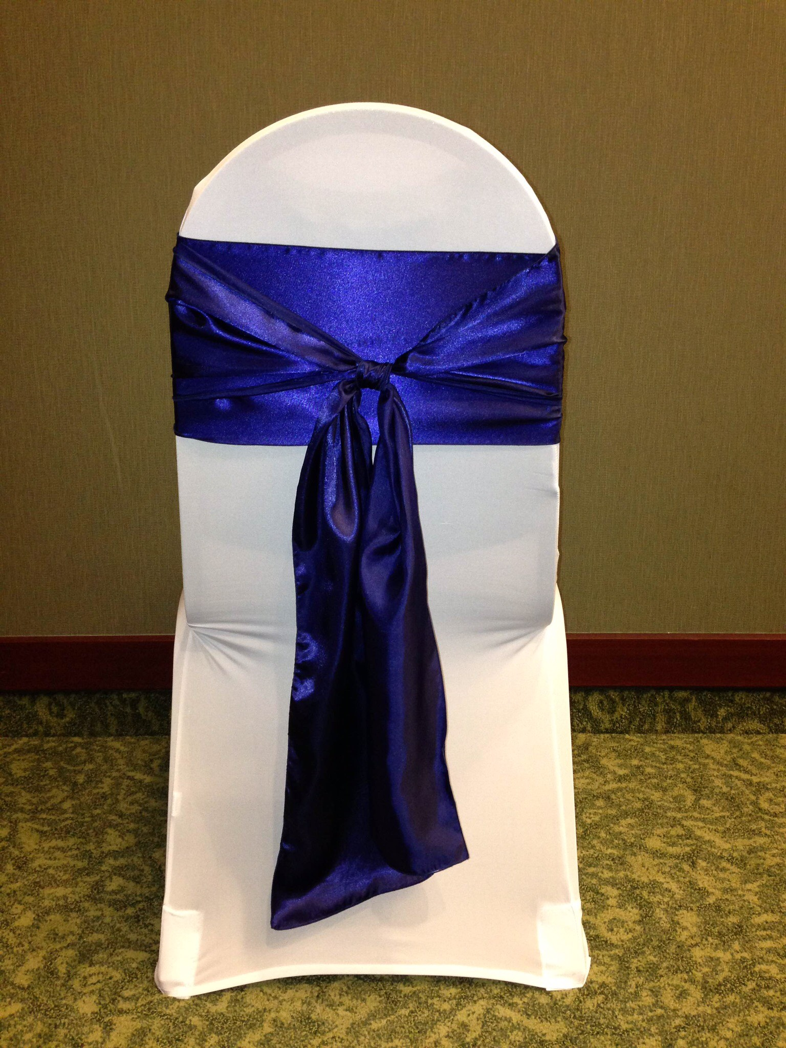 Navy sash with white chair cover