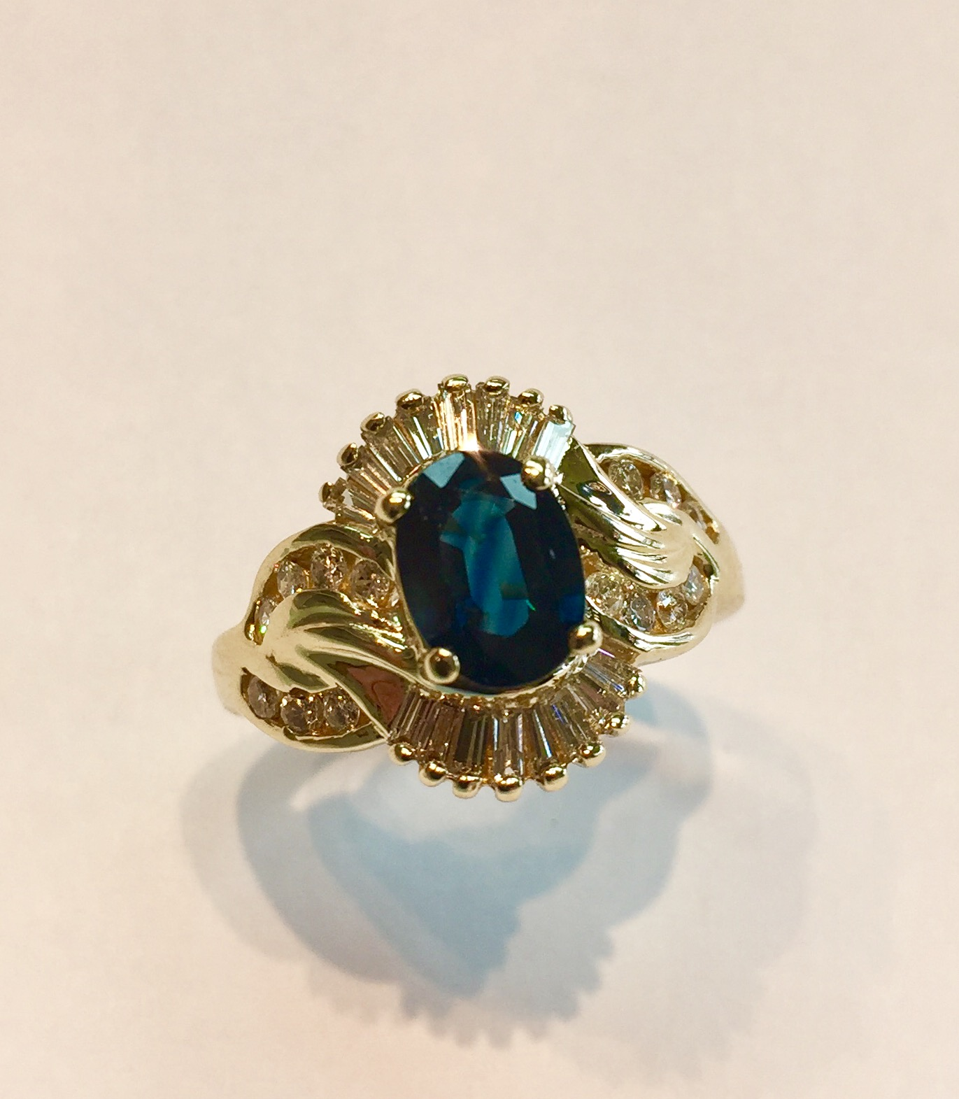 Item AB21 USD 745  14k Yellow Gold Blue Sapphire Diamond Ring  A classic ring with approximately 1.55 carat of sapphire and .45 carat of sparkling white diamonds.  Pristine condition.