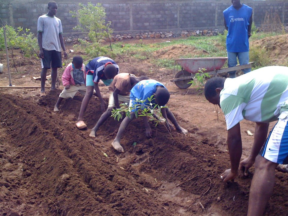 """Pastor Daniel with a """"planting brigade"""", passing on the skills of planting food."""