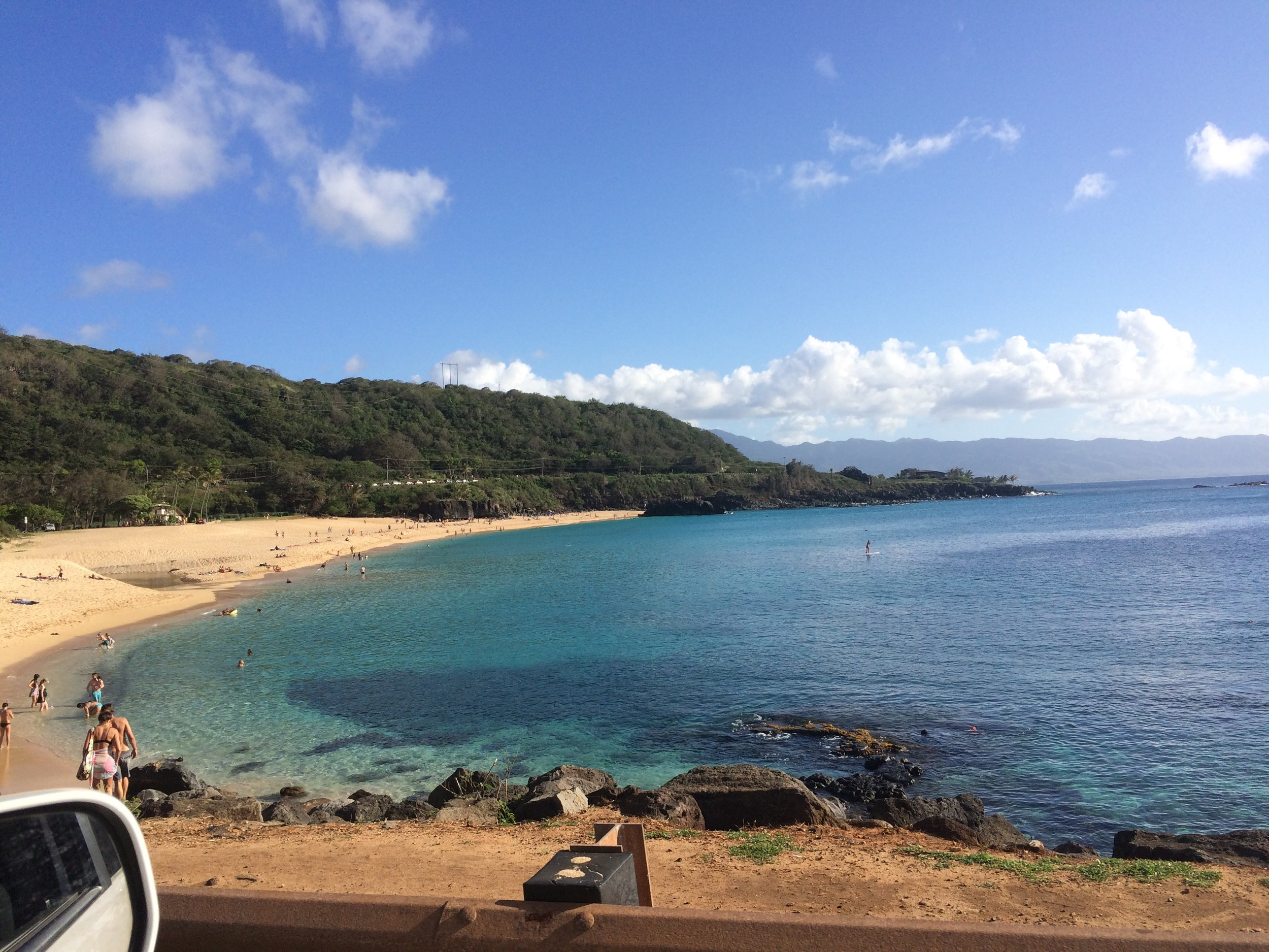 EDIT: For those unfamiliar with surf and Hawaii,I took this drive-by photo yesterday as we were passing Waimea Bay where the Eddie took place this past winter—such a stark difference, eh? The water was it's typical summer-pancake-like-self :) AND what a beautiful day, I must add. Look at those colors!