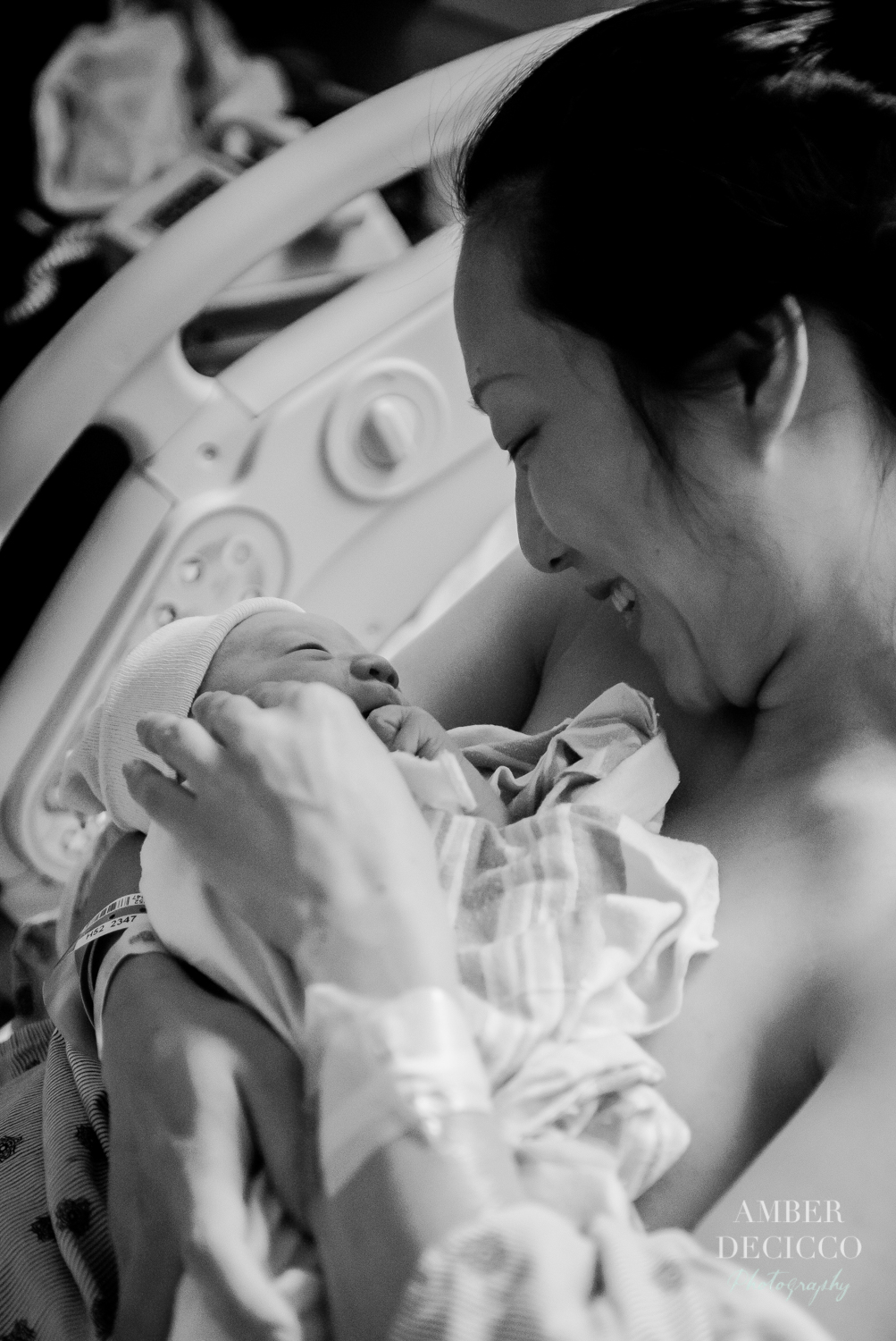 Mom admiring her baby | Birth Photography ©Amber DeCicco Photography
