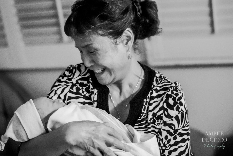 Grandma meets her Grandchild | Birth Photography ©Amber DeCicco Photography