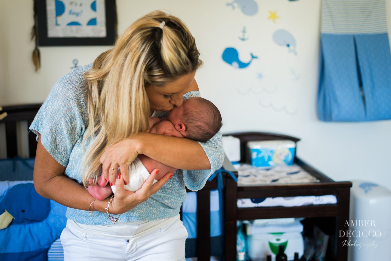 Mother kisses newborn