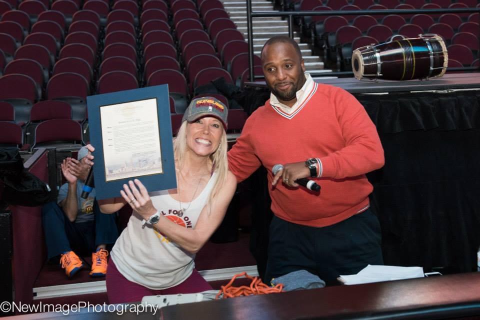 Tammy Lyons accepts Mayor Jackson's Proclamation from Cavs hypeman Ahmaad Crump.