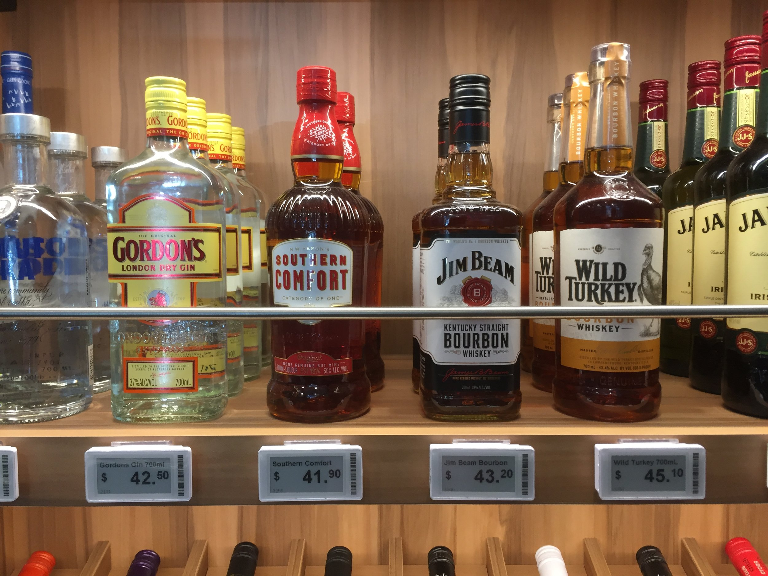 Sydney bottle shop liquor display with digital price tags