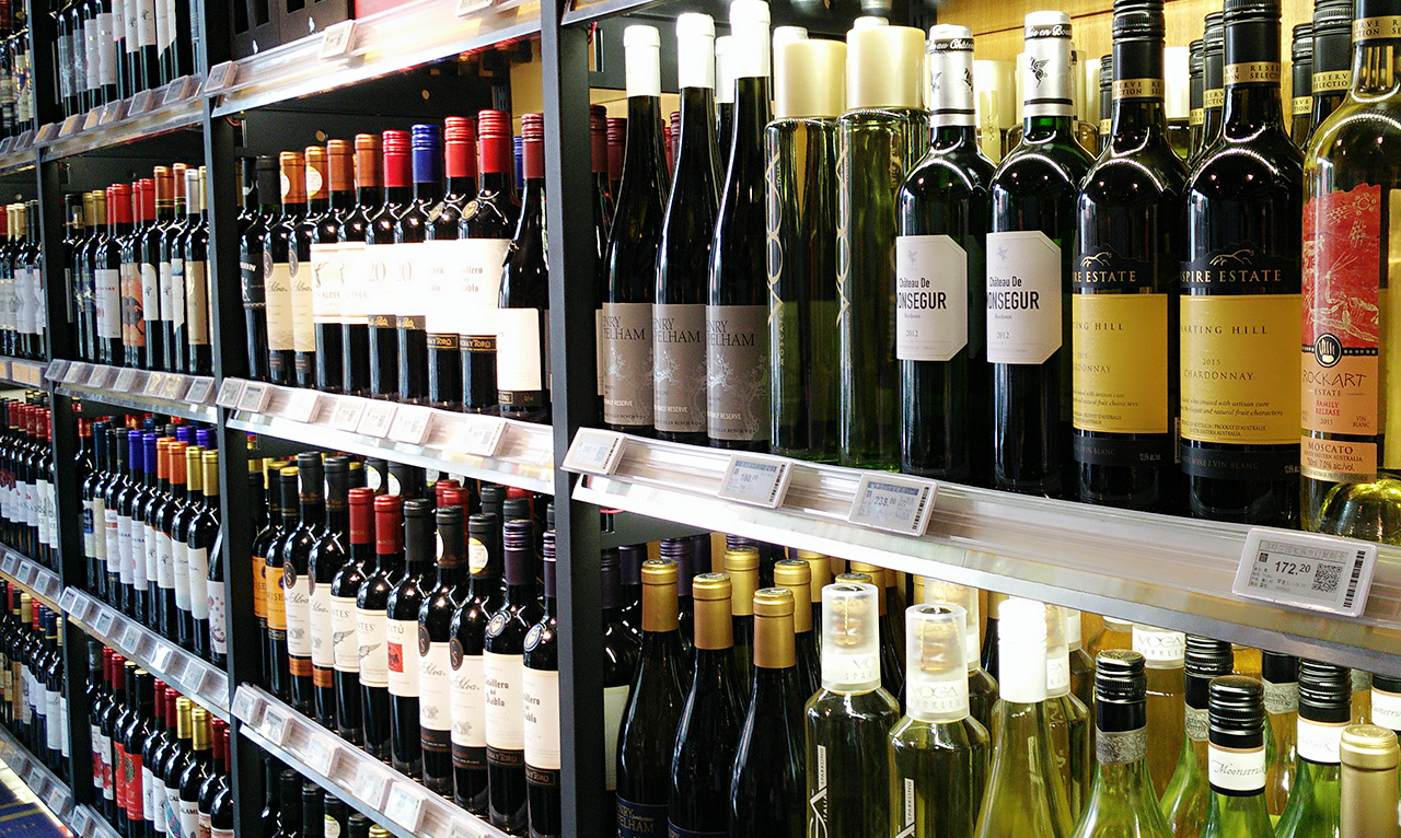 ESLs attached to wine shelves in a bottle shop