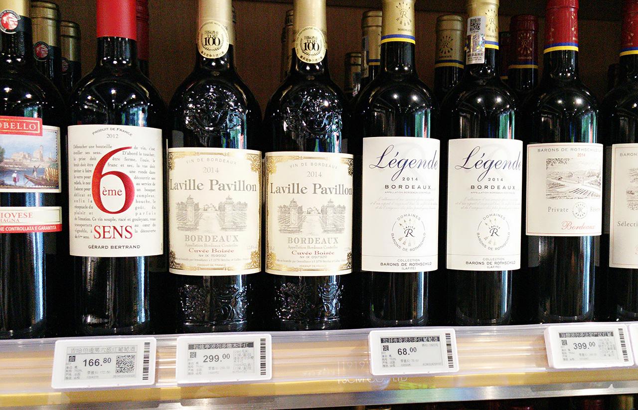 Bottle shop wine shelf with digital price labels