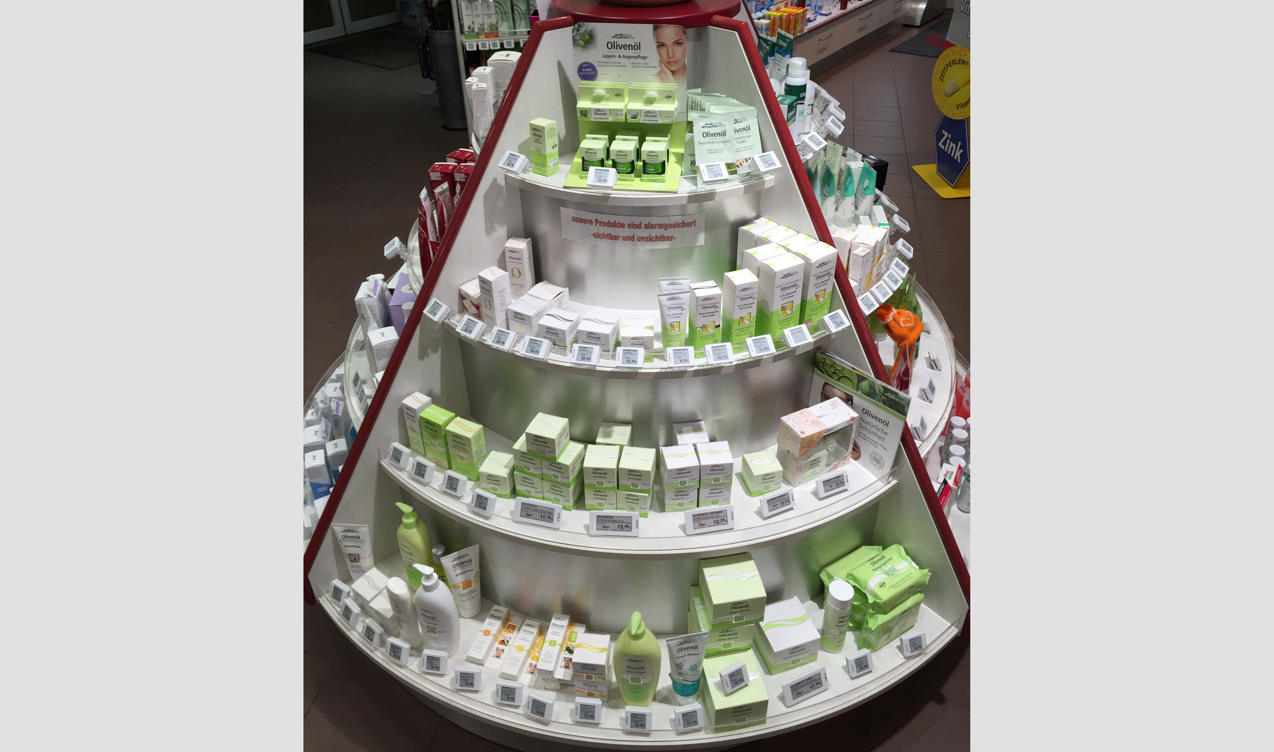 Digital pricing labels are fixed to a circular Pharmacy product display