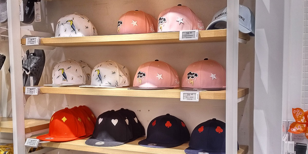 Electronic shelf labels used for hats on shelves in an apparel store