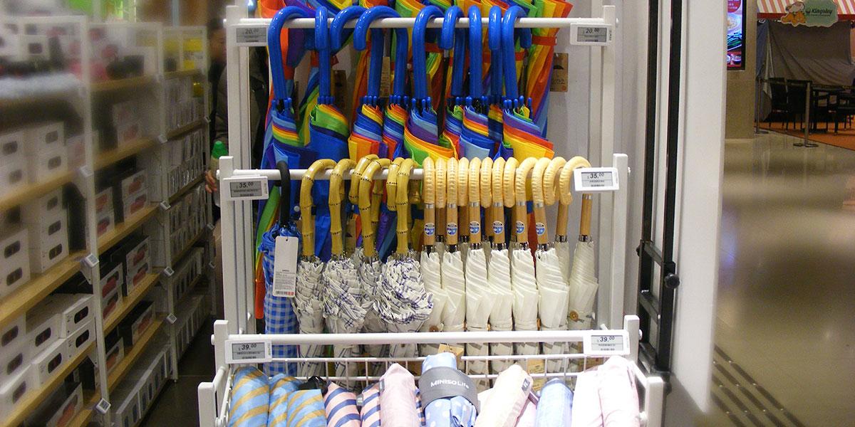 ESLs show digital pricing for umbrellas in a department store