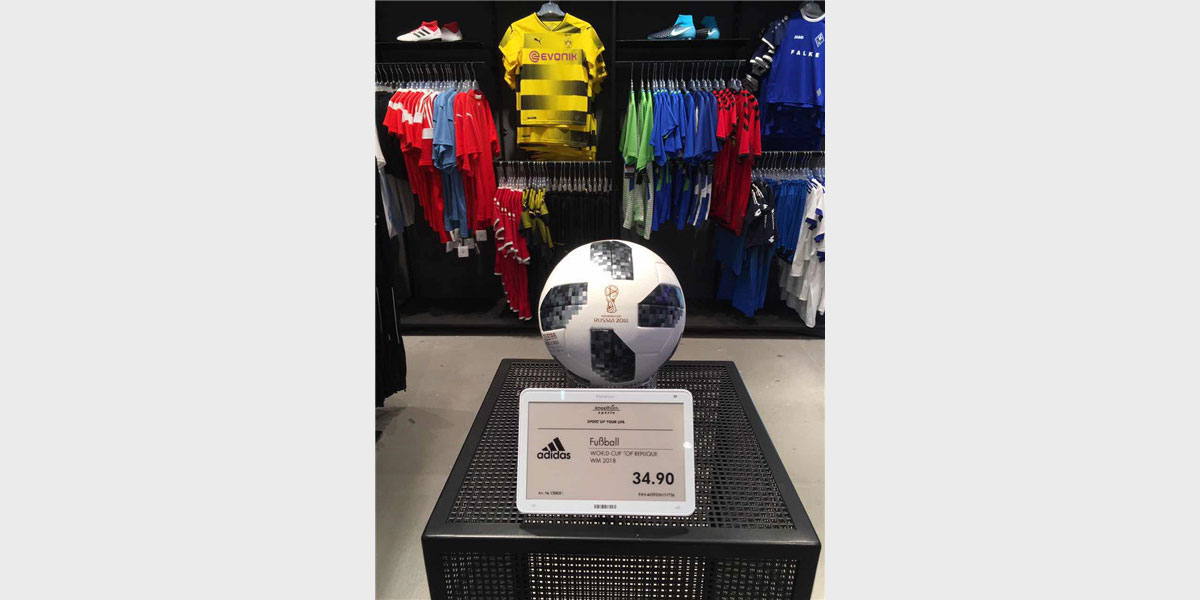 Large electronic price tag used to display pricing in a sports clothing store