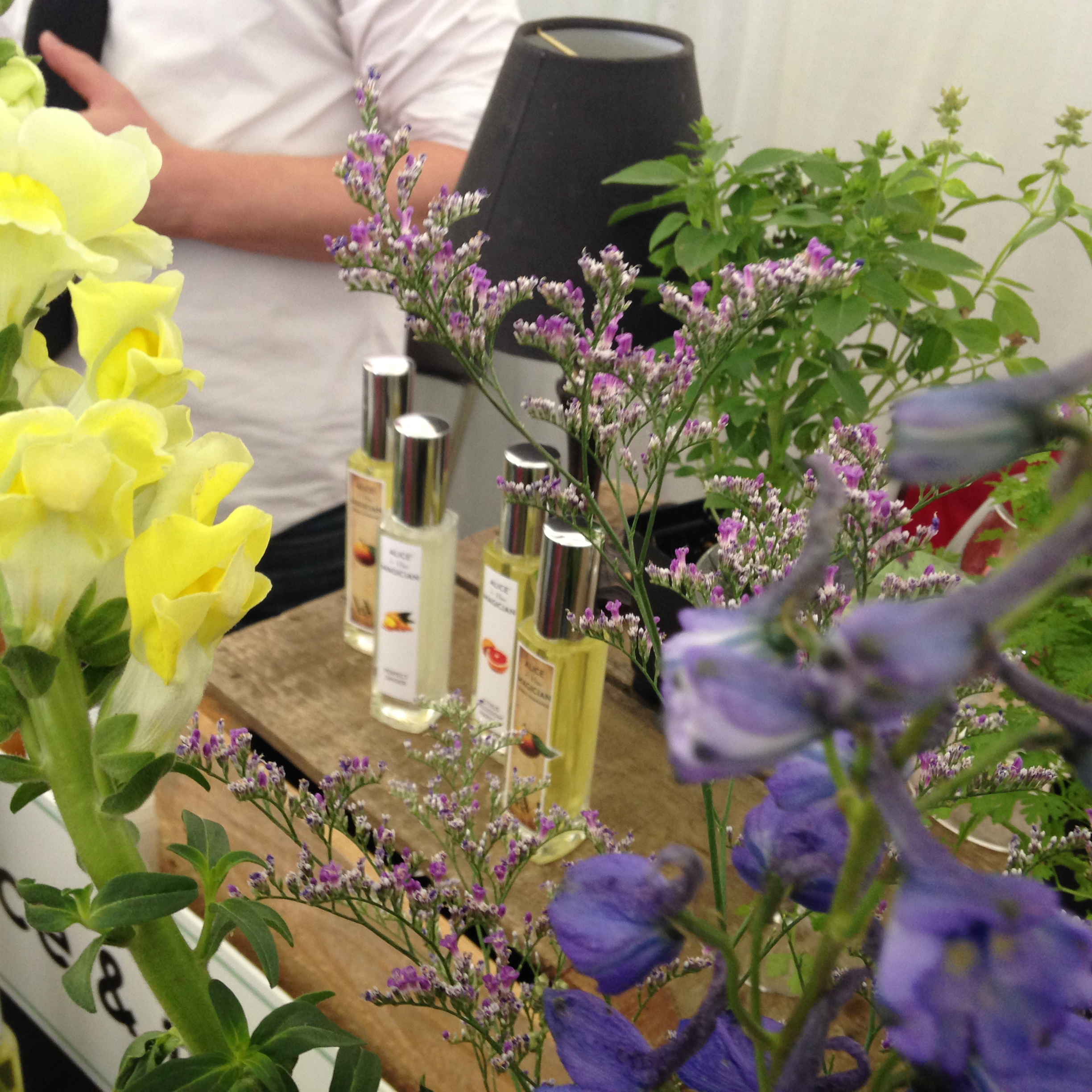 local herbs and fresh flowers highlight our display and our vision for a farm-to-bottle fragrance.