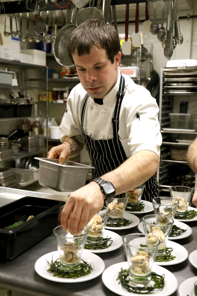 Chef Jean-Luc Matecat plating the first course. Photo by Lindsay Taylor