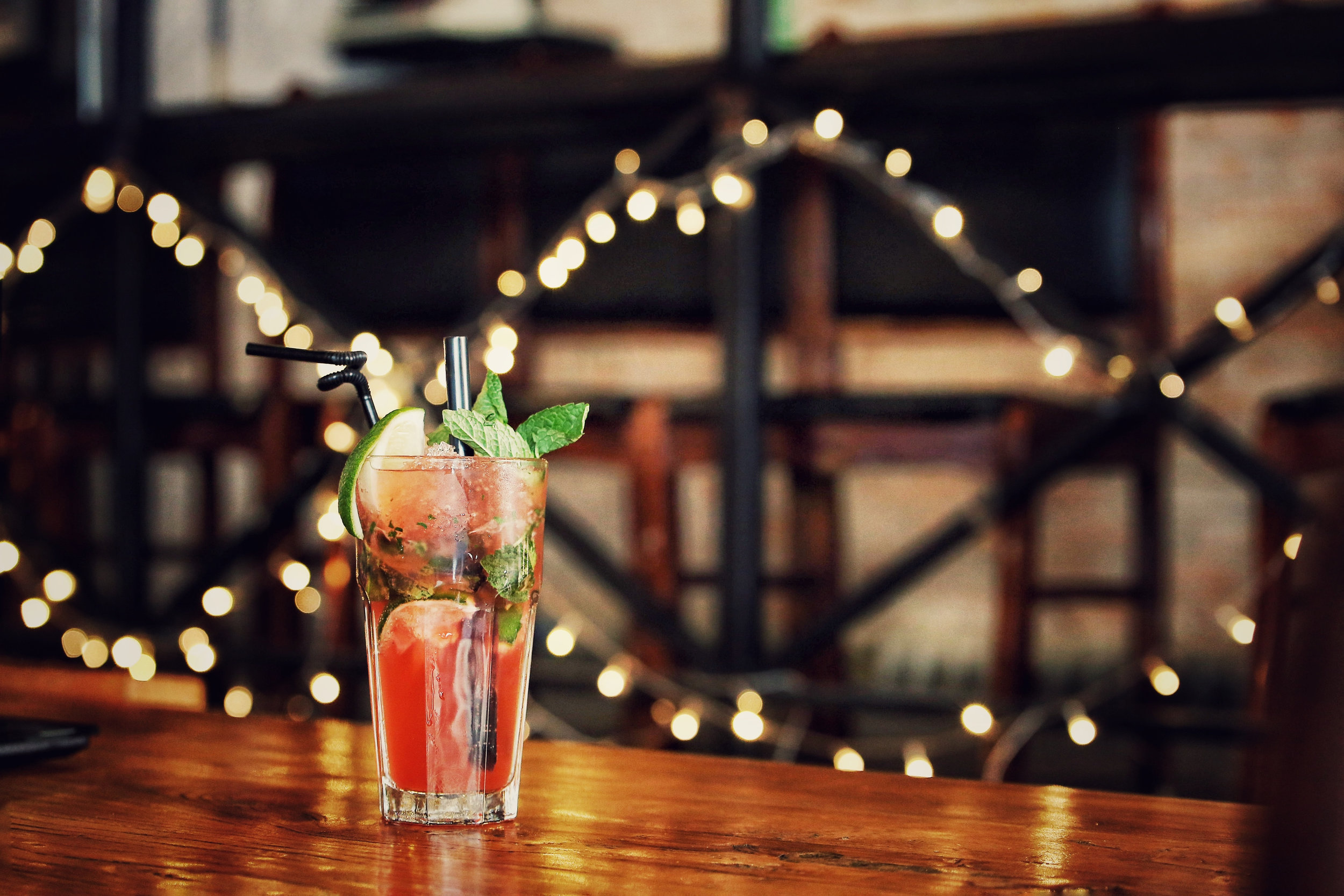 jazzfest cocktail pic with string lights.jpg