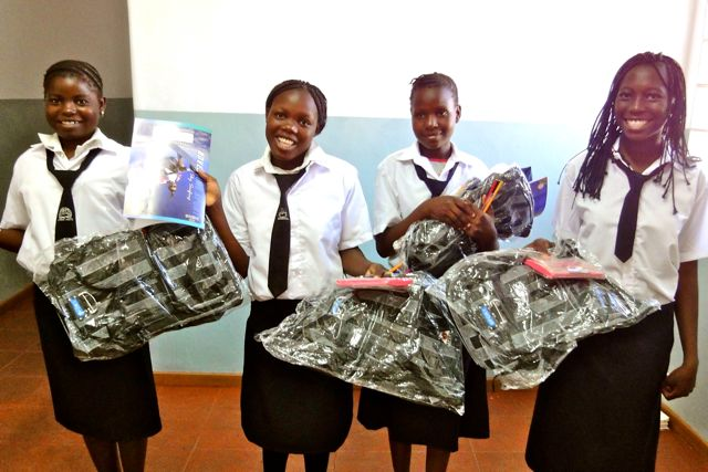 Four of our sponsored girls with their new school bags
