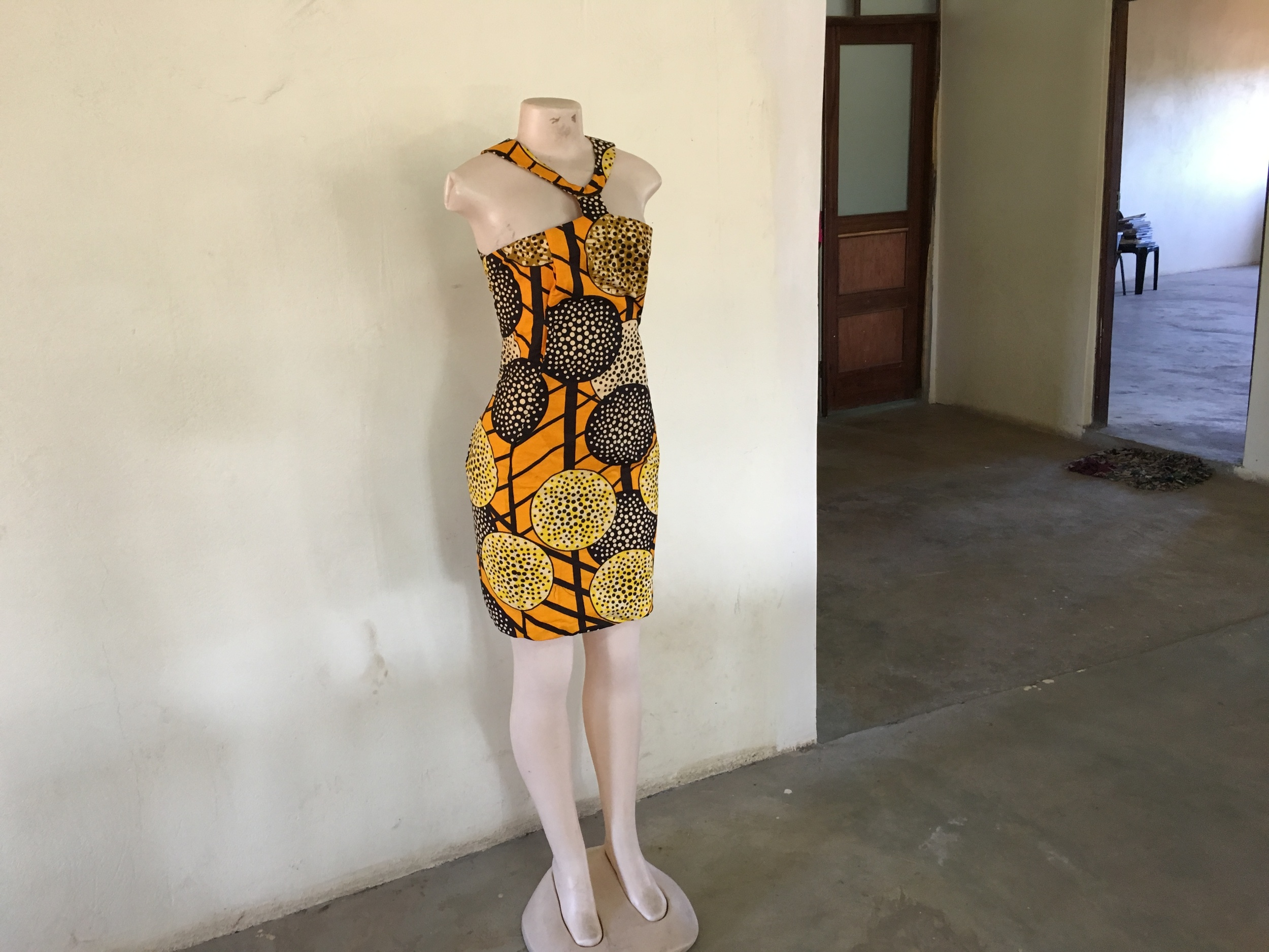 A dress made by a student of sewing classes in Boane.