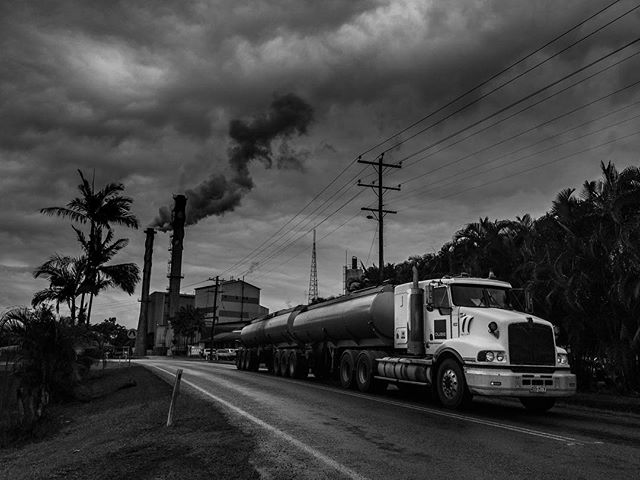 Carbon footprint! #Australia #QLD #menacreek #blackandwhitephotography #iphonephotooftheday #iphoneraw #lighroommobile #trucks #cludyday #smoke #cairns #roadtrip #sugarcane #sugarcanefactory #highcontrast #sky #art #instagood #bnw #monochrome #monotone #queensland #travel #trip