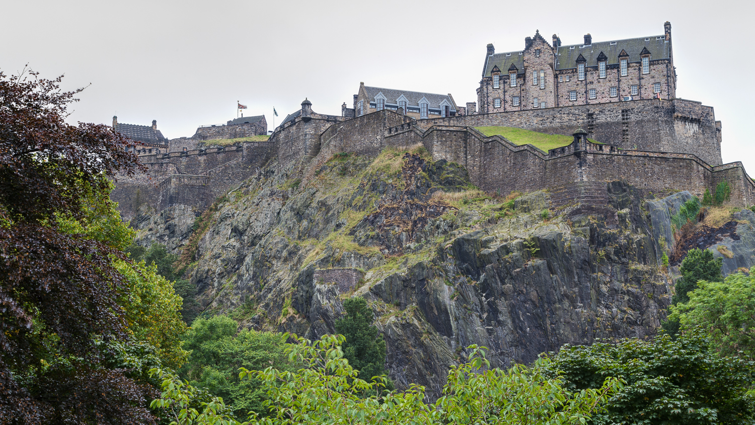 Edinburgh Castle is a historic fortress which dominates the skyline of the city from its position on the Castle Rock.