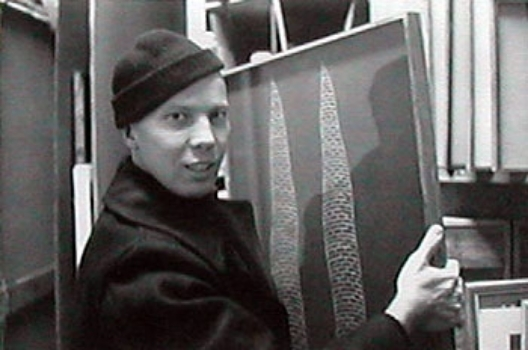 Artist Ray Johnson with painting.