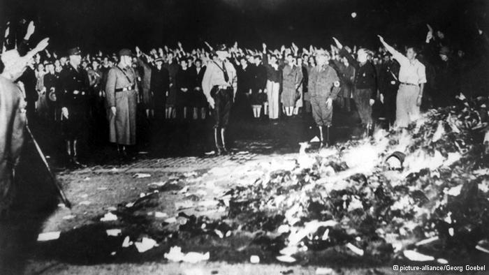 Nazis burning art and literature.